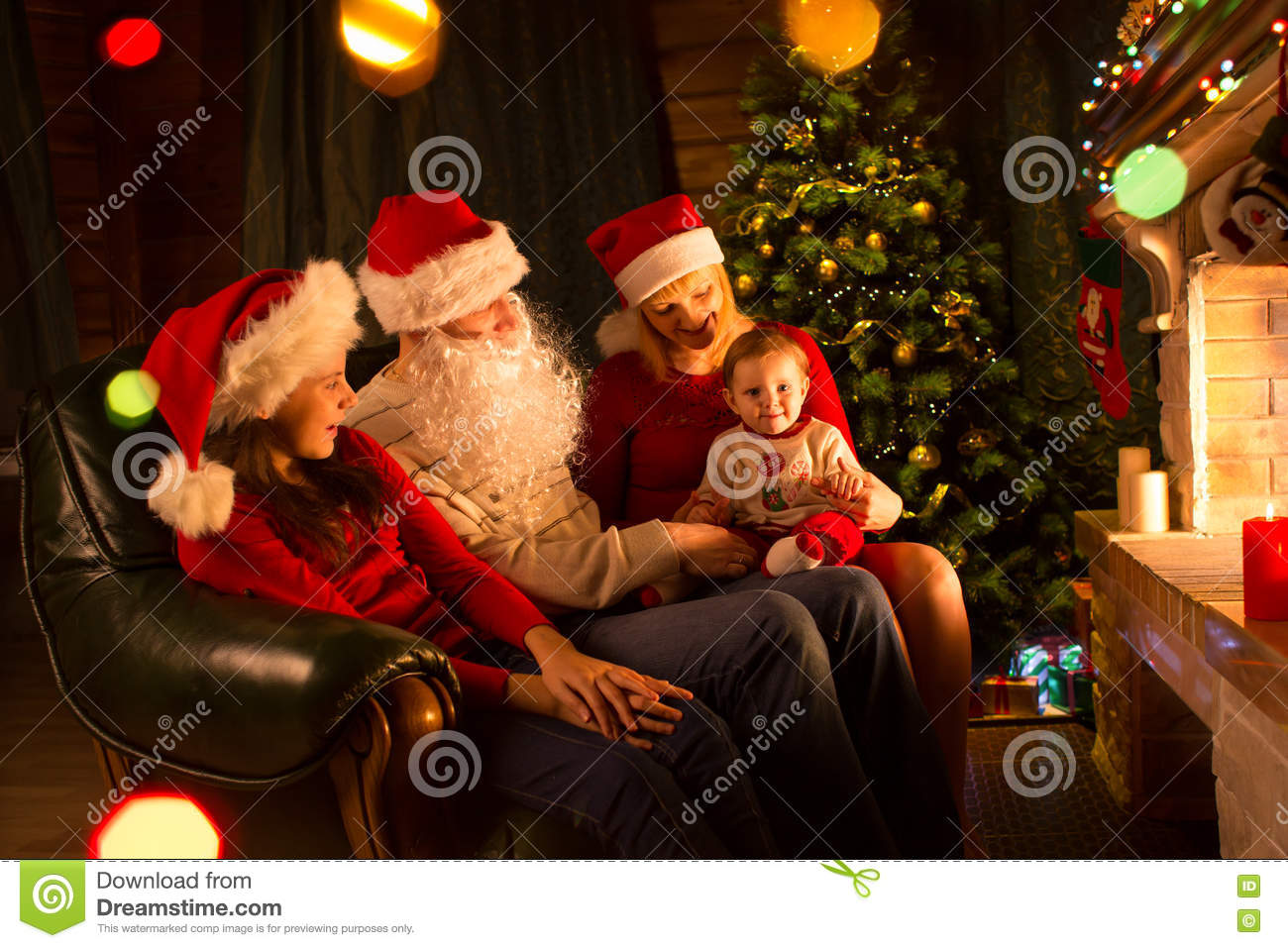 Family portrait in home holiday living room at Christmas tree