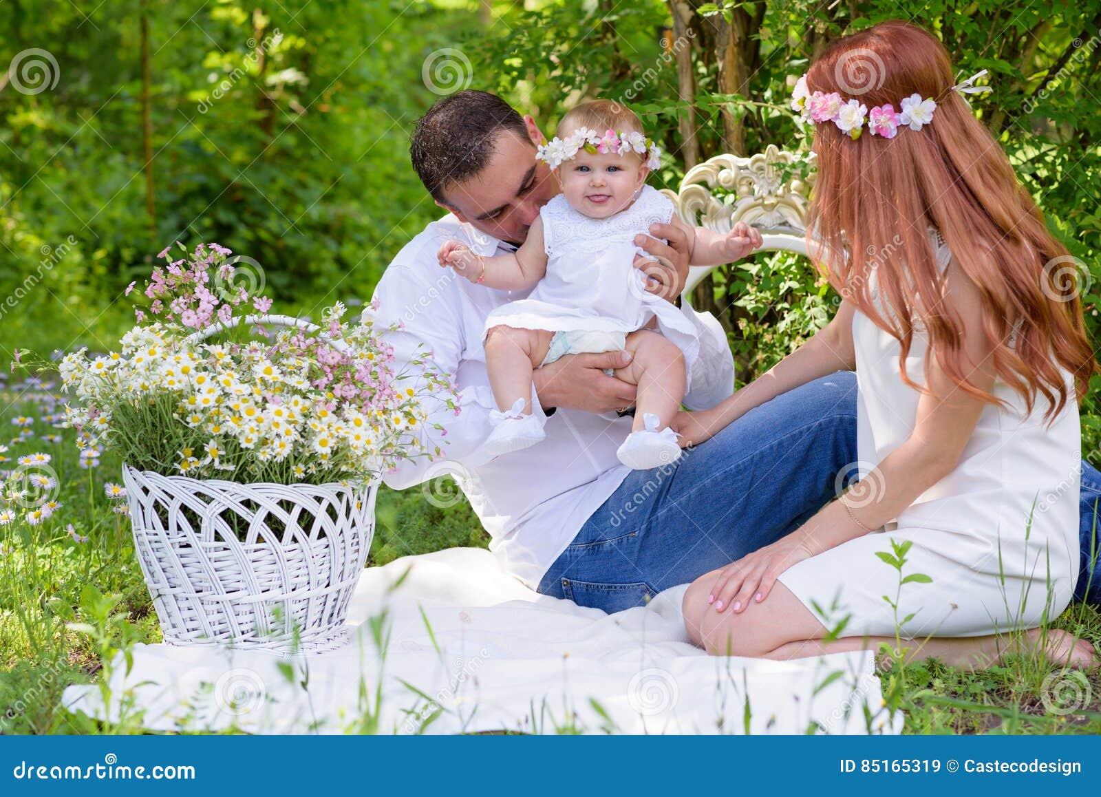 Family portrait outdoors picnic