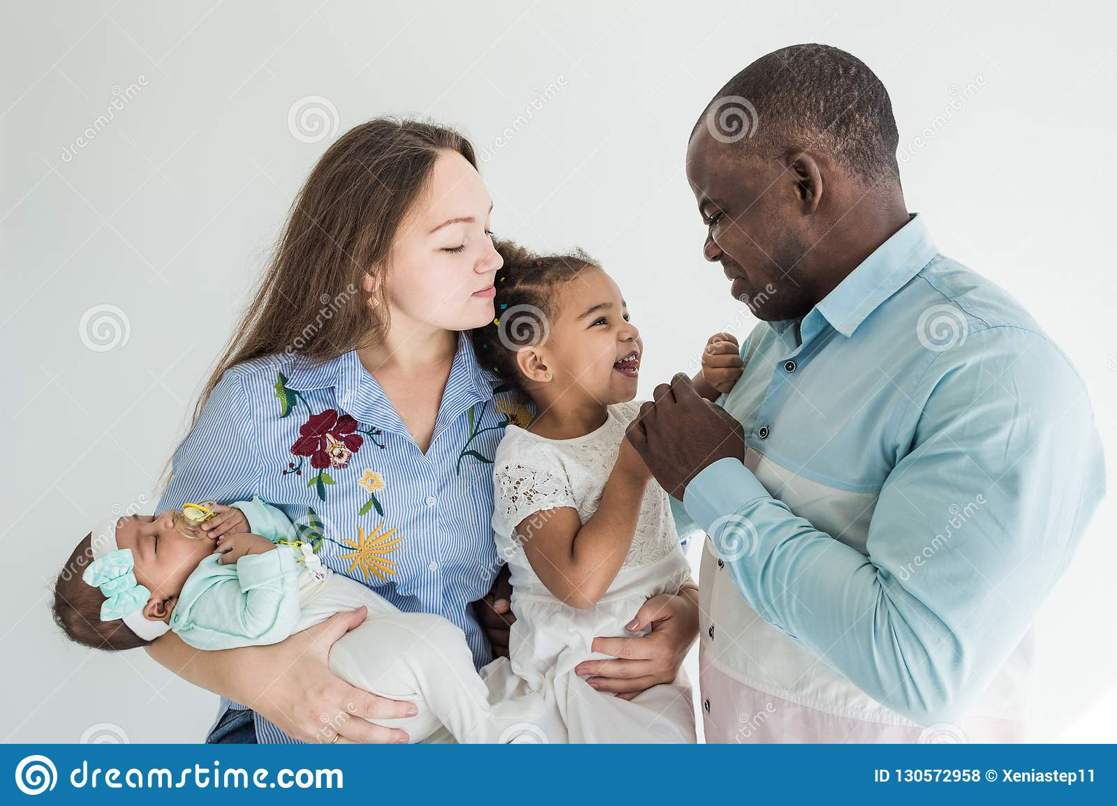 Family portrait on a white background happy multiethnic family family values