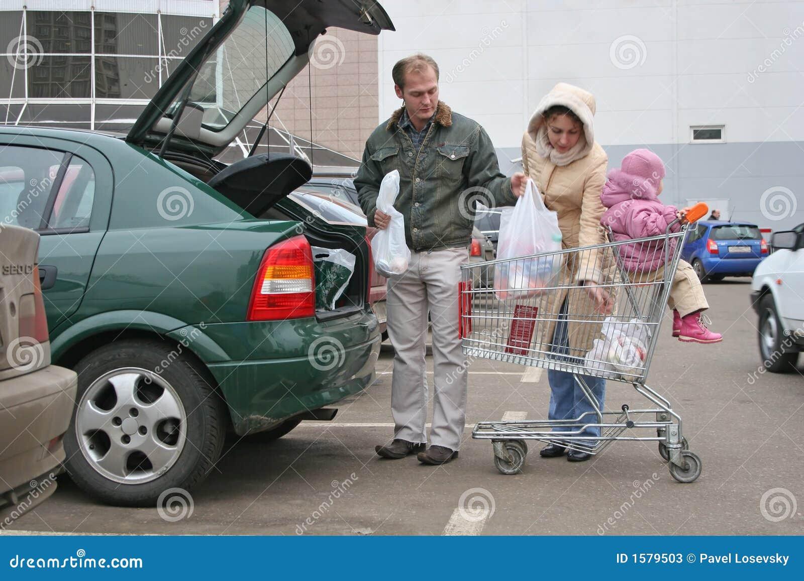 Family Puting Shopping Bags In Car Stock Photos Image 1579503