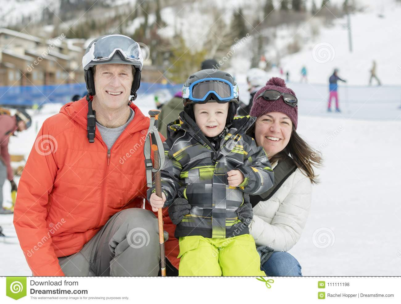 c17202dfa8e4 Family Ready To Ski With A Toddler Boy Dressed In All Safety Gear ...