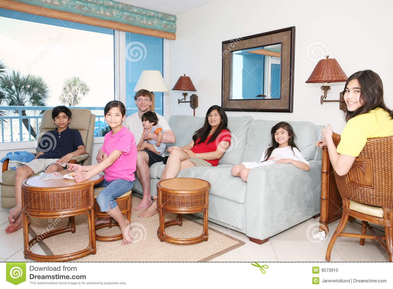 Family Relaxing In Living Room Stock Image - Image of mother, rattan ...