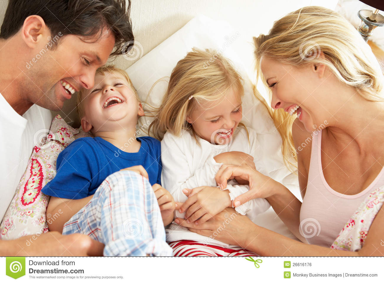 Loving Family Parents Bedroom Family Relaxing Together In Bed Royalty Free Stock Image