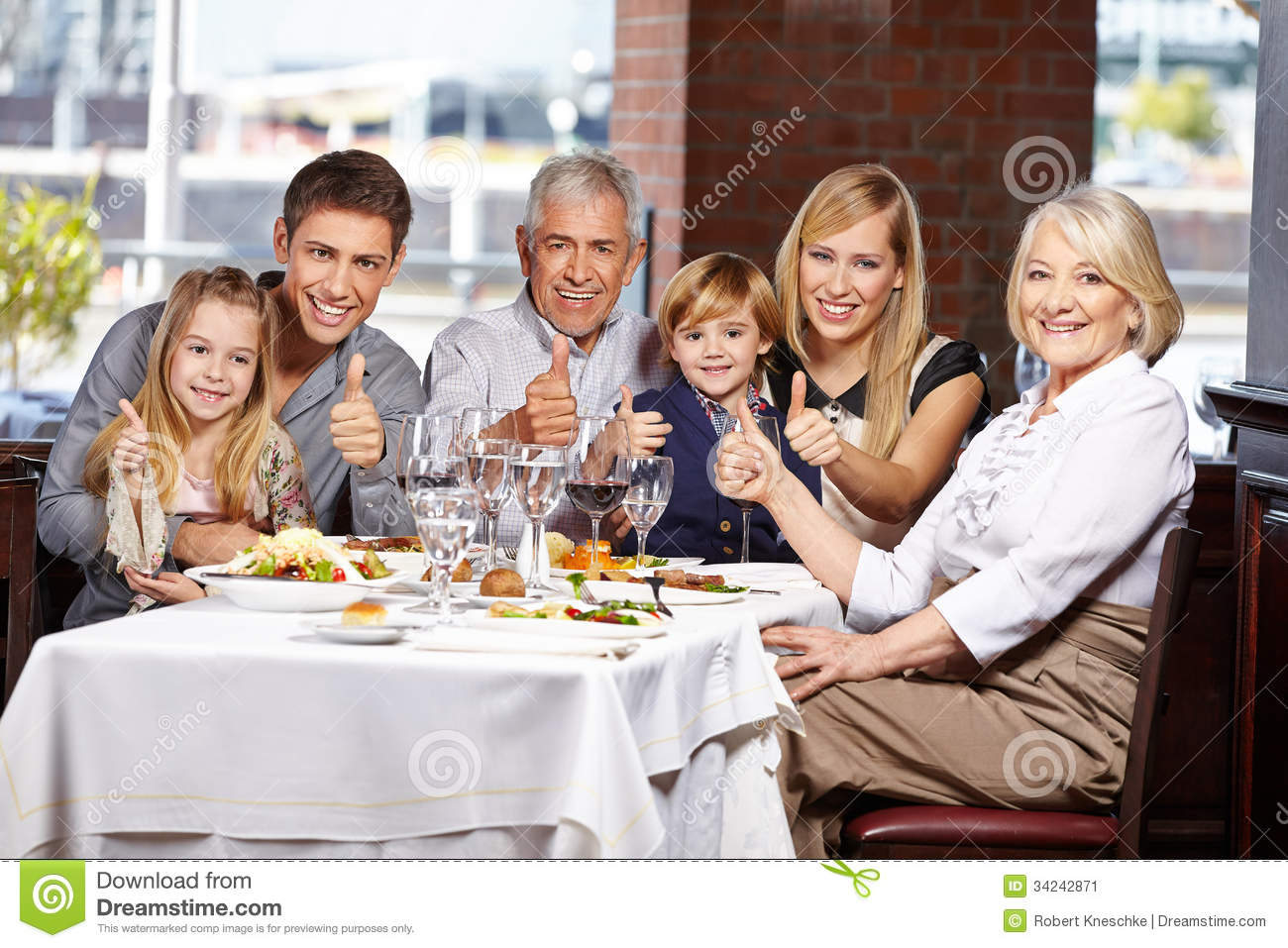 Family in restaurant holding thumbs stock image image of for Family diner