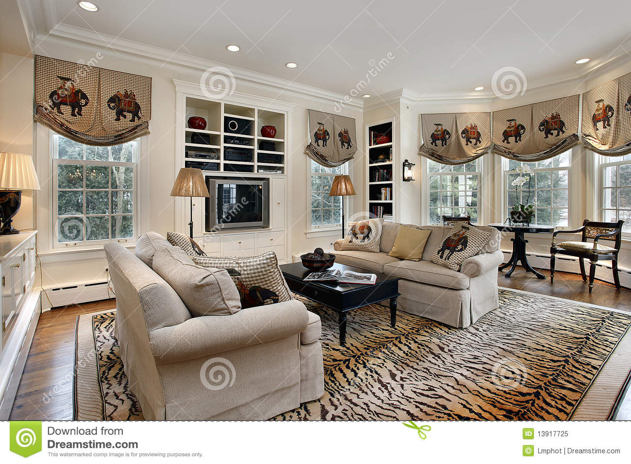 Family room with built in cabinets royalty free stock for Family room built in cabinets