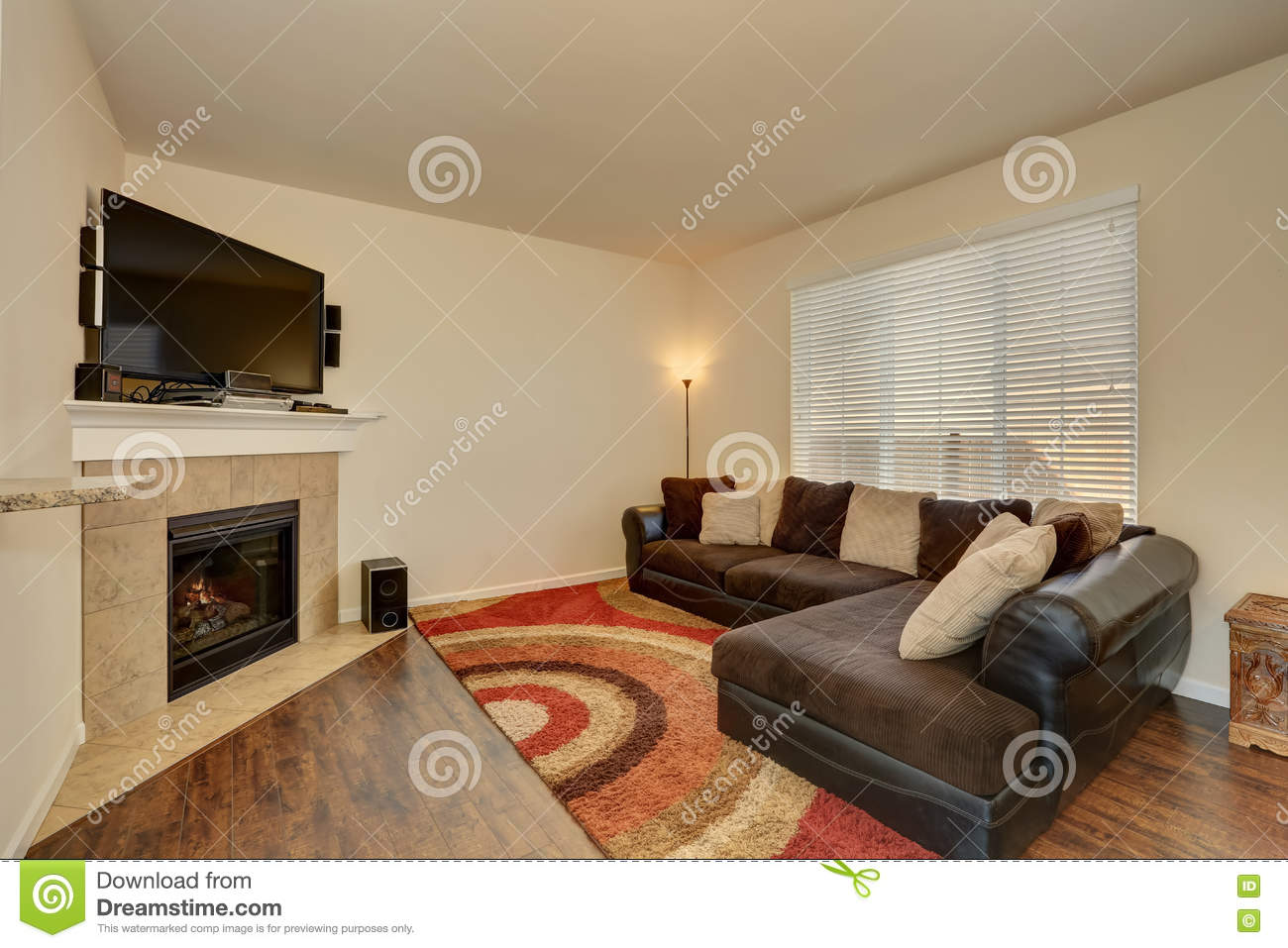 family room interior corner fireplace with tile trim stock image