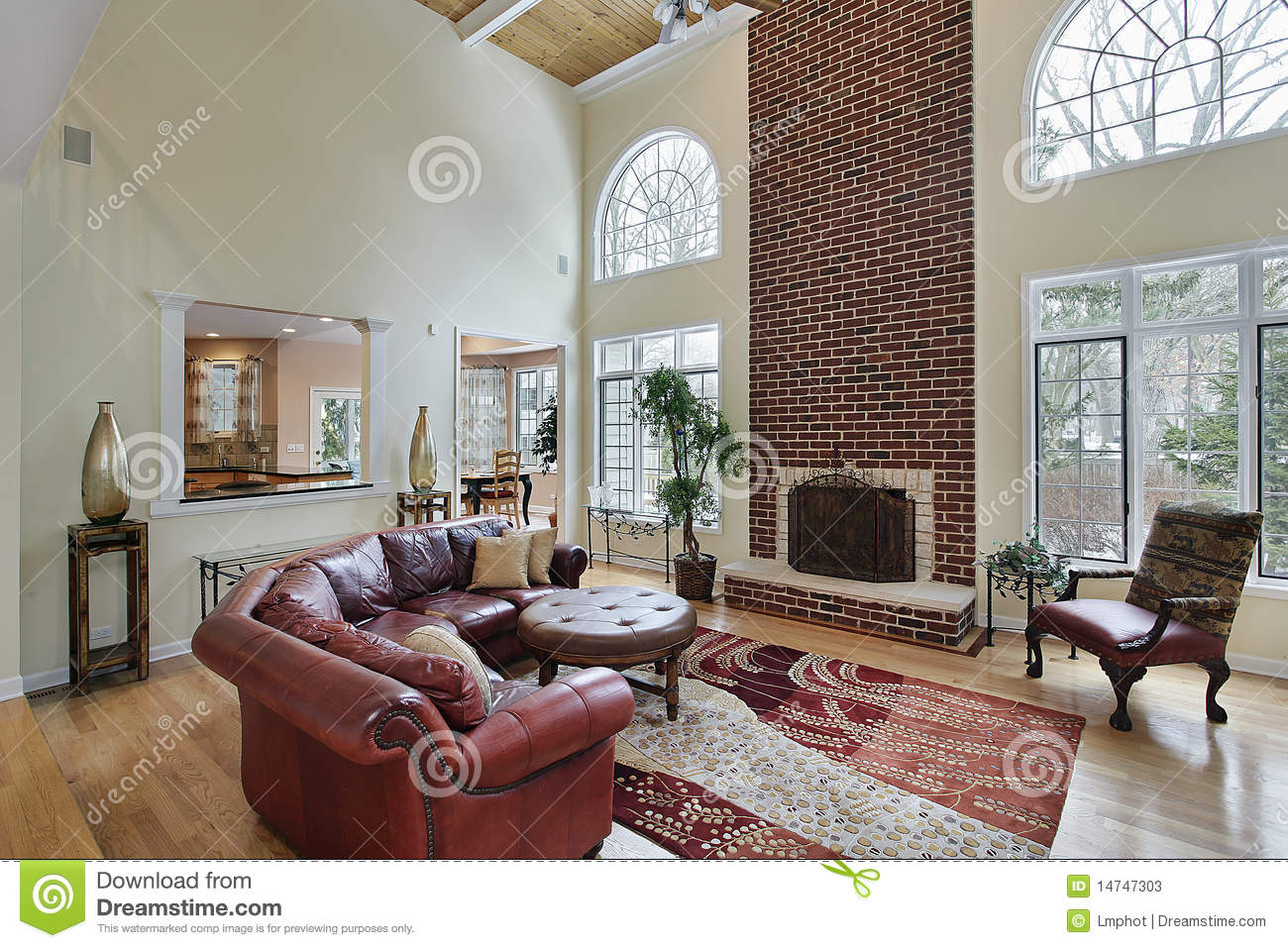 Family Room With Two Story Brick Fireplace Stock Photos