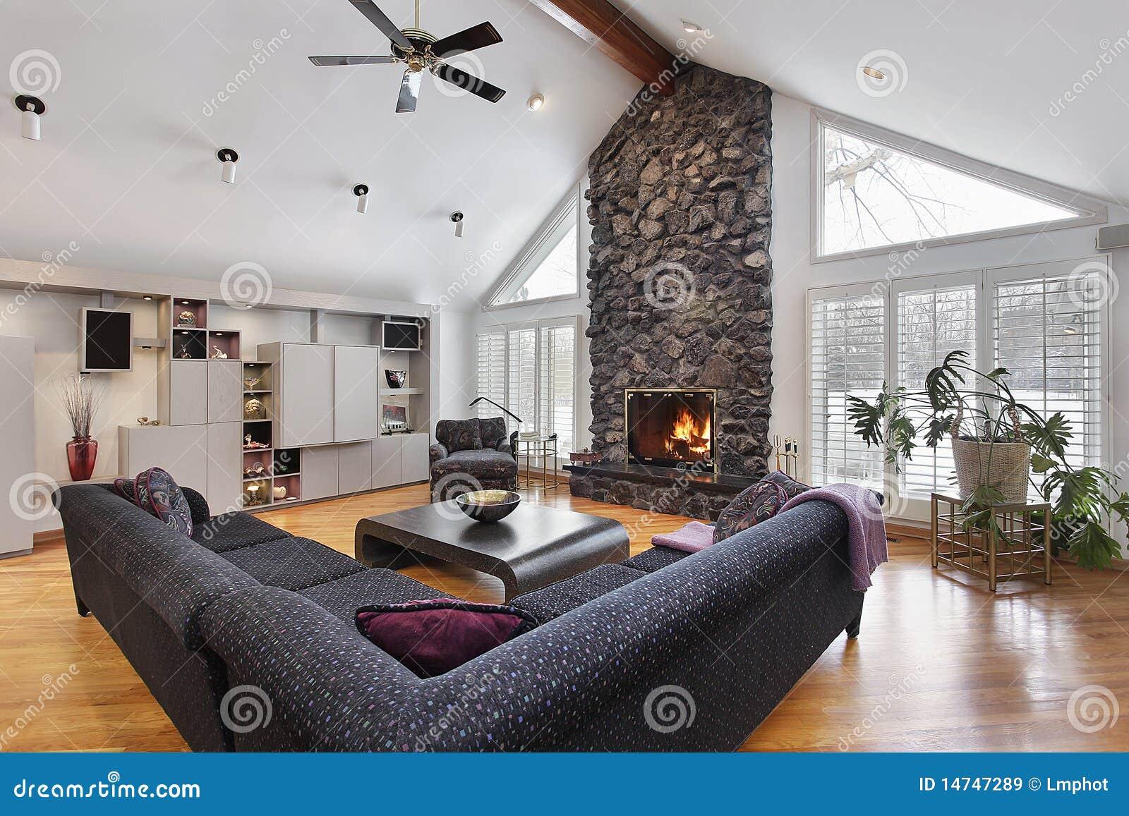 Family room with two story stone fireplace stock image - Chimenea de piedra ...