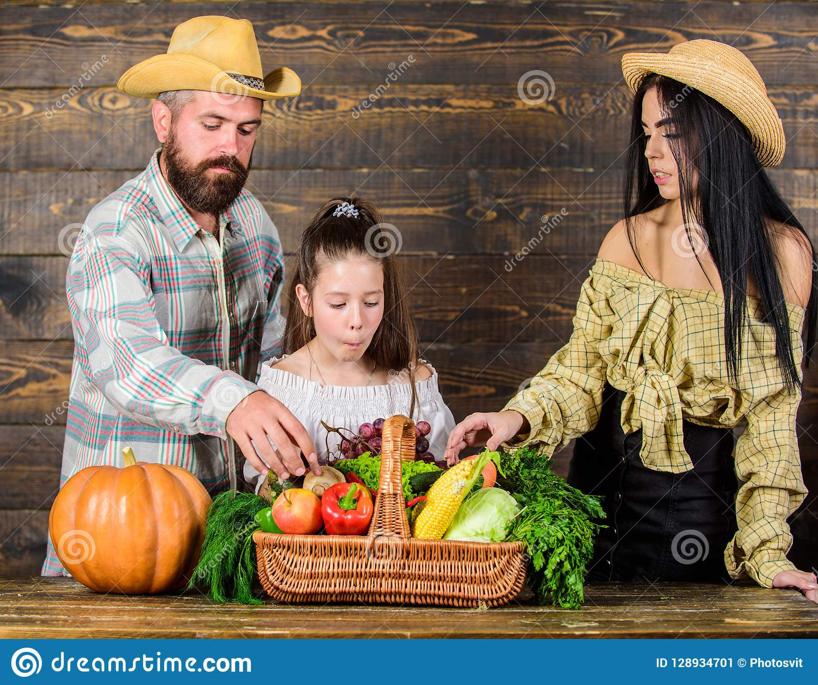 Family rustic style farmers market with fall harvest. Harvest festival concept. Family farmers with harvest wooden