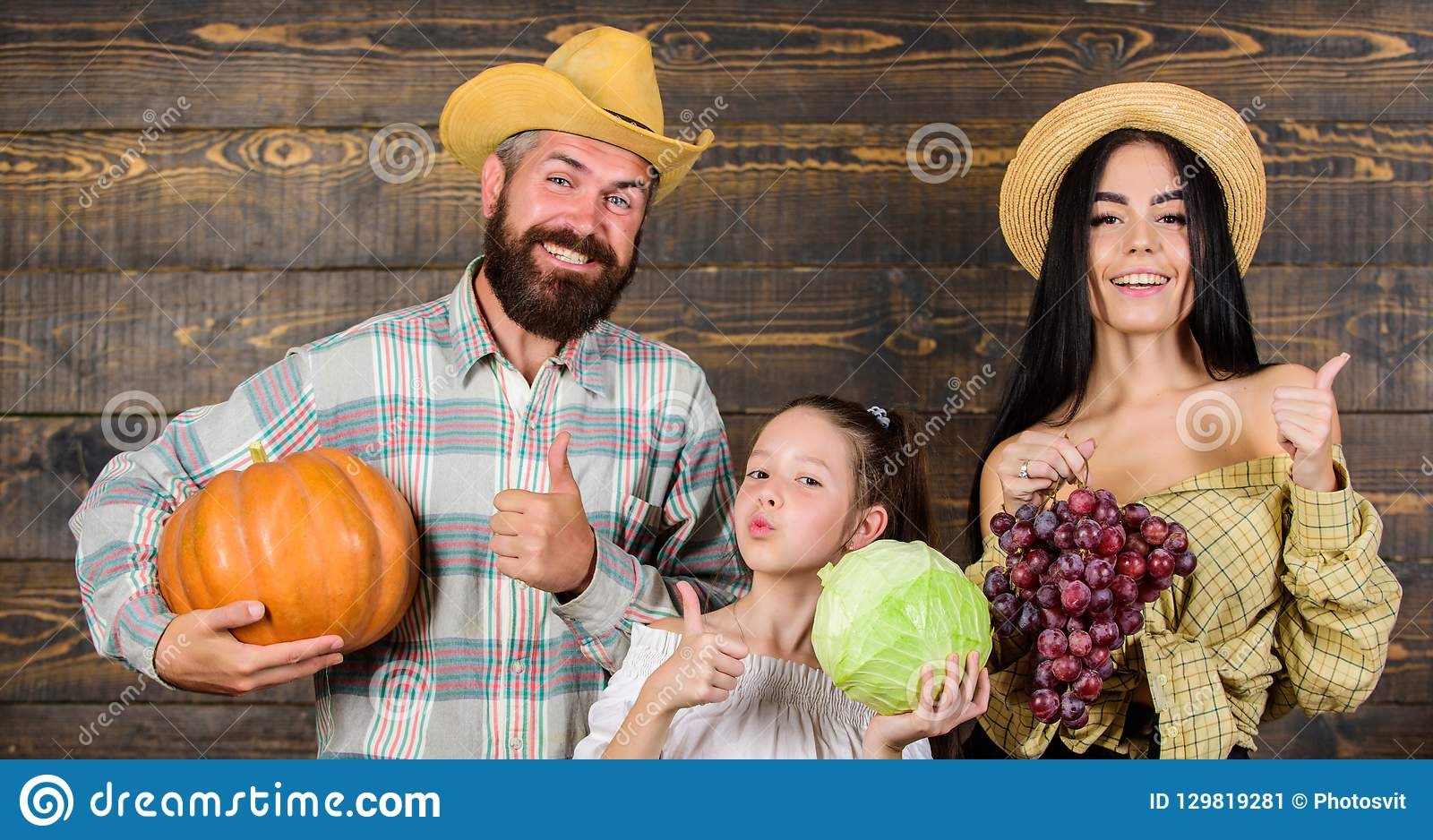 Family rustic style farmers market with fall harvest. Harvest festival concept. Parents and daughter celebrate harvest