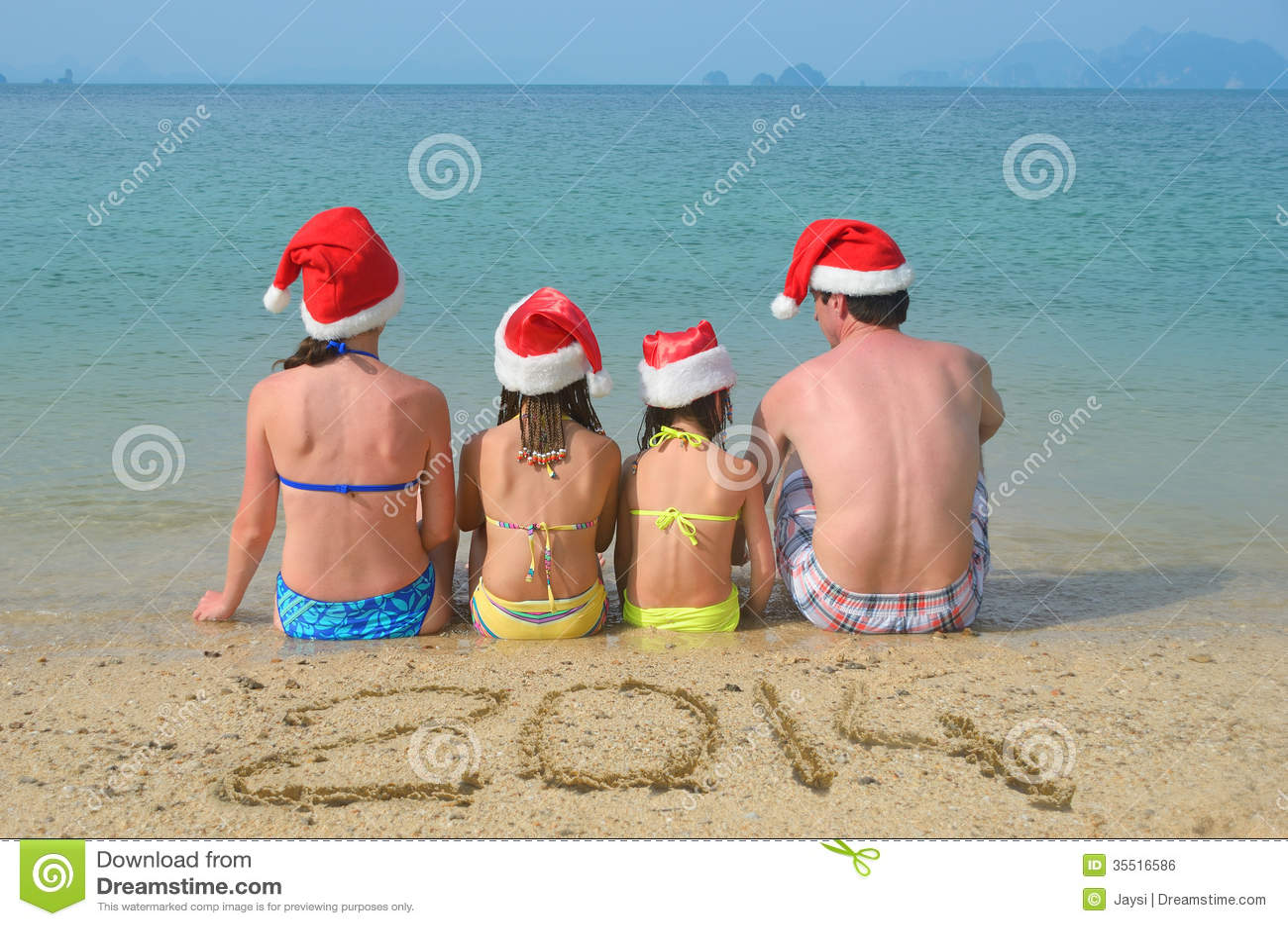 funny christmas card photo ideas for kids - Family In Santa Hats Having Fun Beach Stock