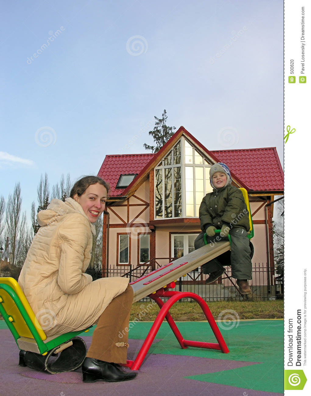 Family on seesaw and home
