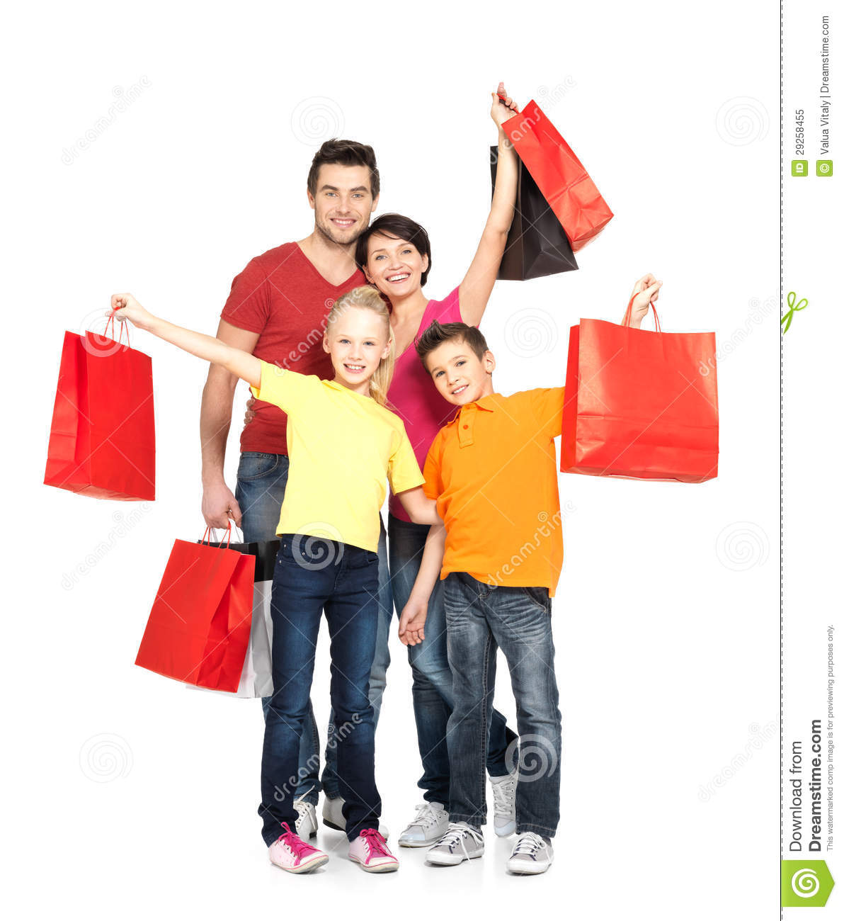 Family With Shopping Bags Standing At Studio Royalty Free Stock Photo ...