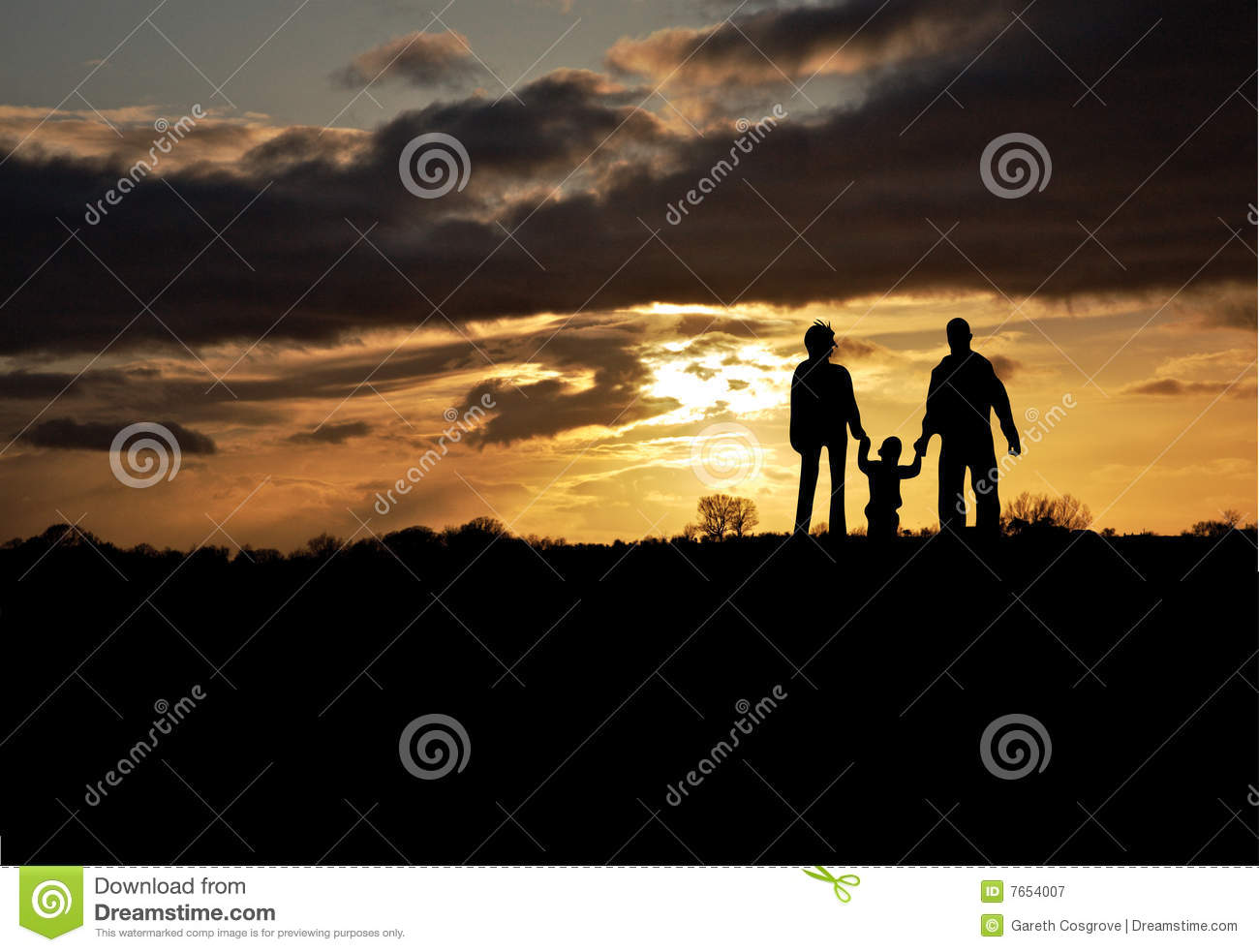 Family silhouetted at sunset