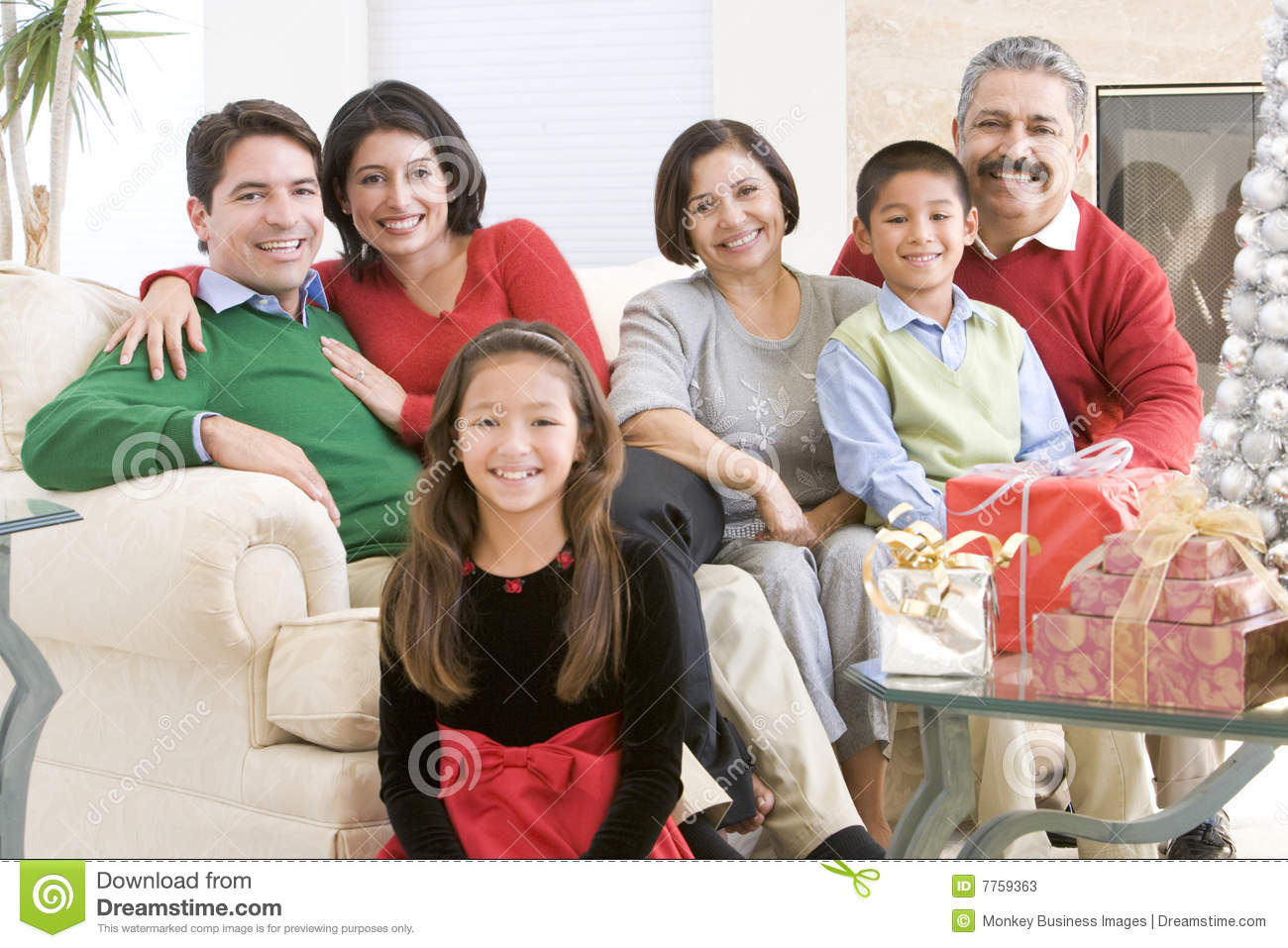 Family Sitting Around A Coffee Table
