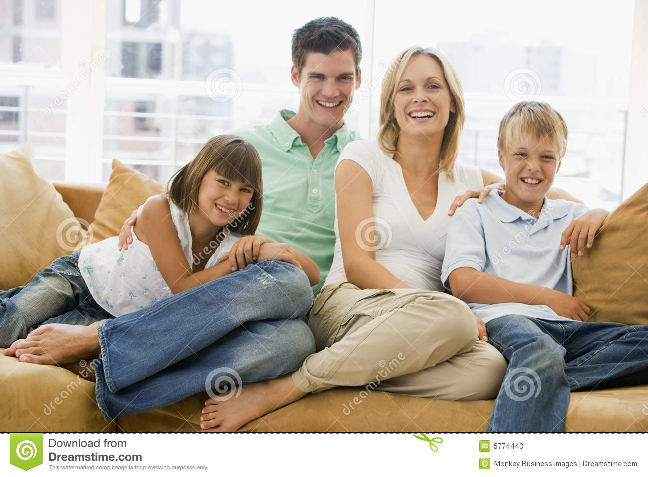 sitting in living room family sitting in living room smiling stock photos image 14576