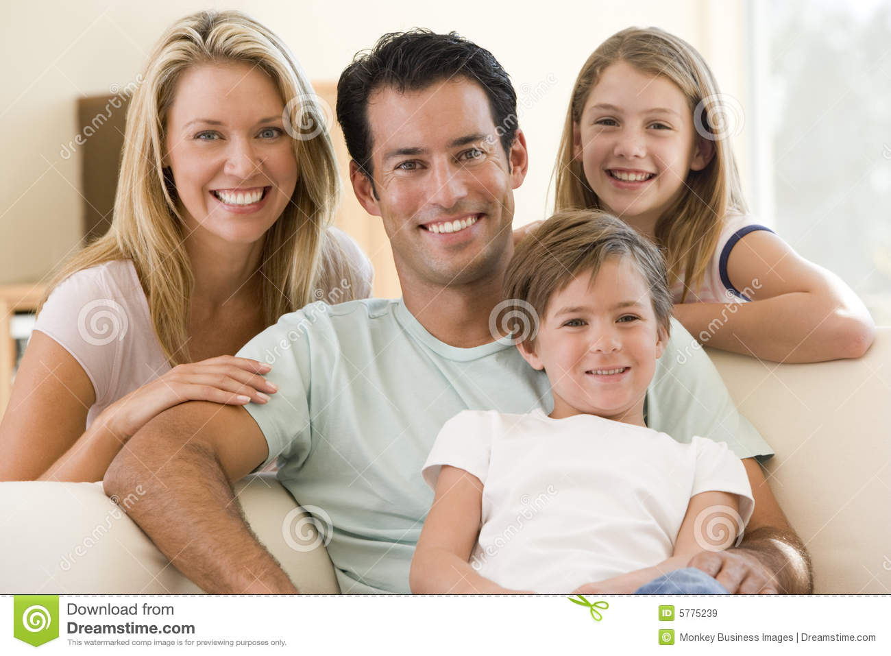 Living Room Family In Living Room family sitting in living room smiling royalty free stock images smiling