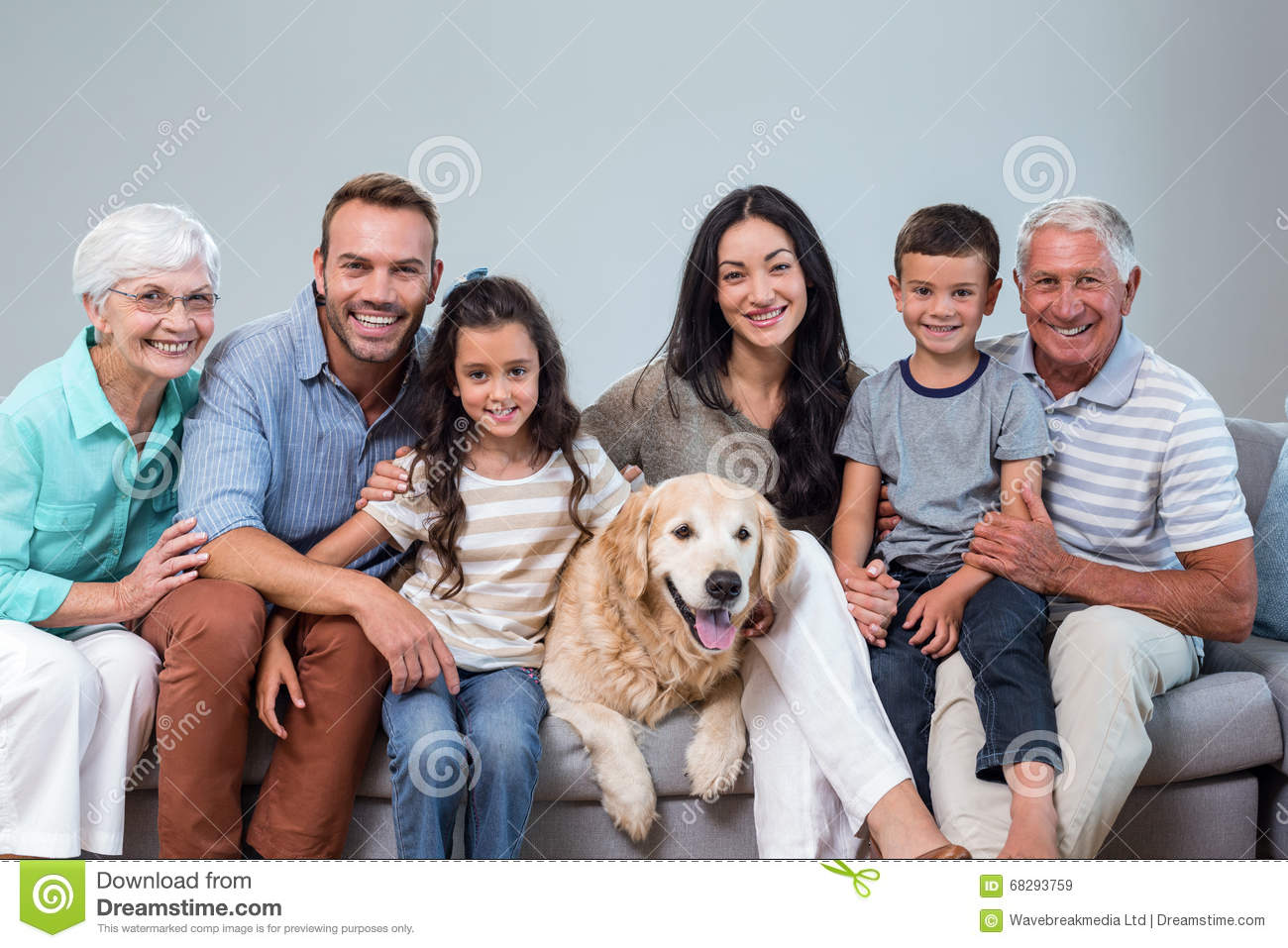 Family sitting on sofa with dog