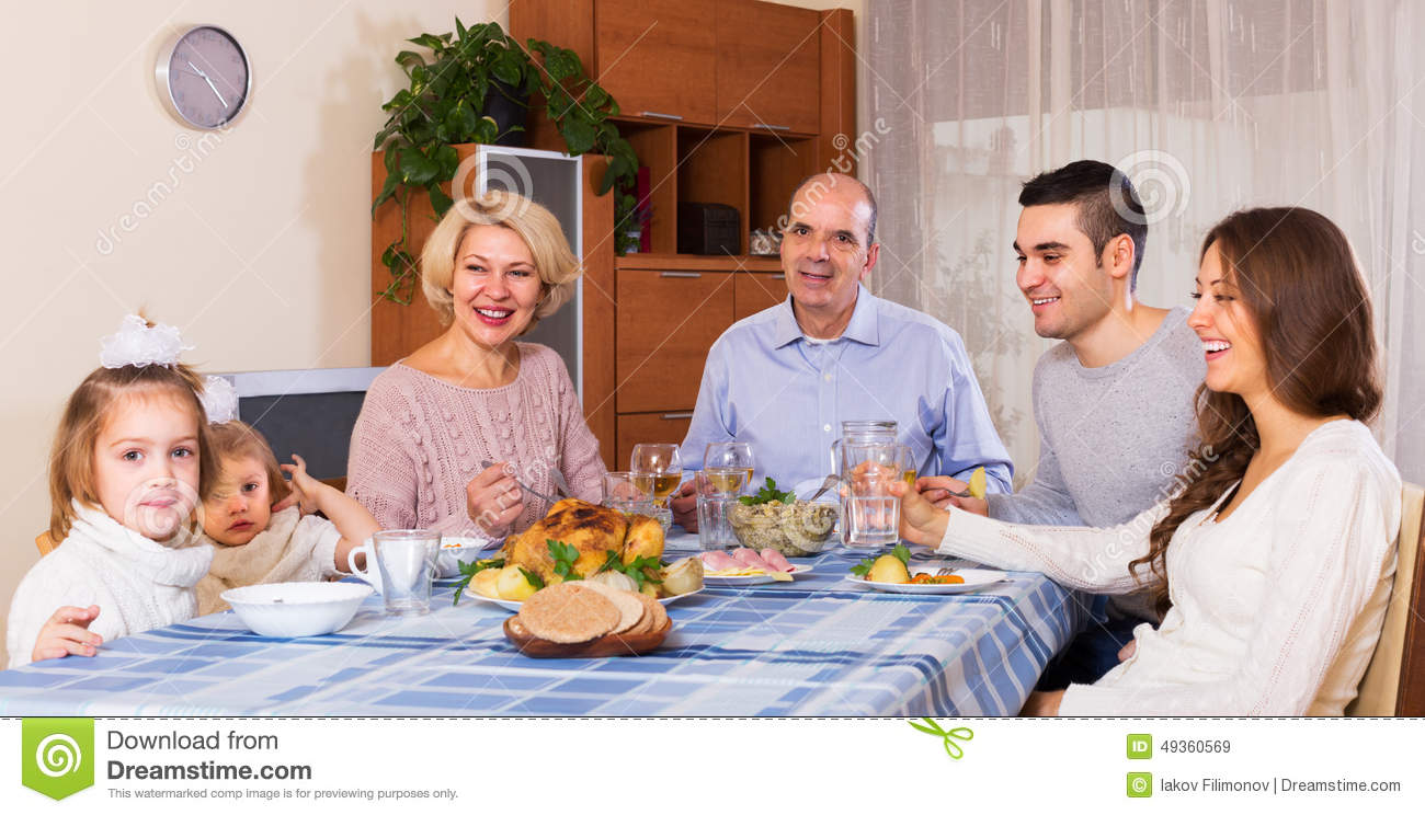 Family Sitting At Table For Dinner Stock Photo Image