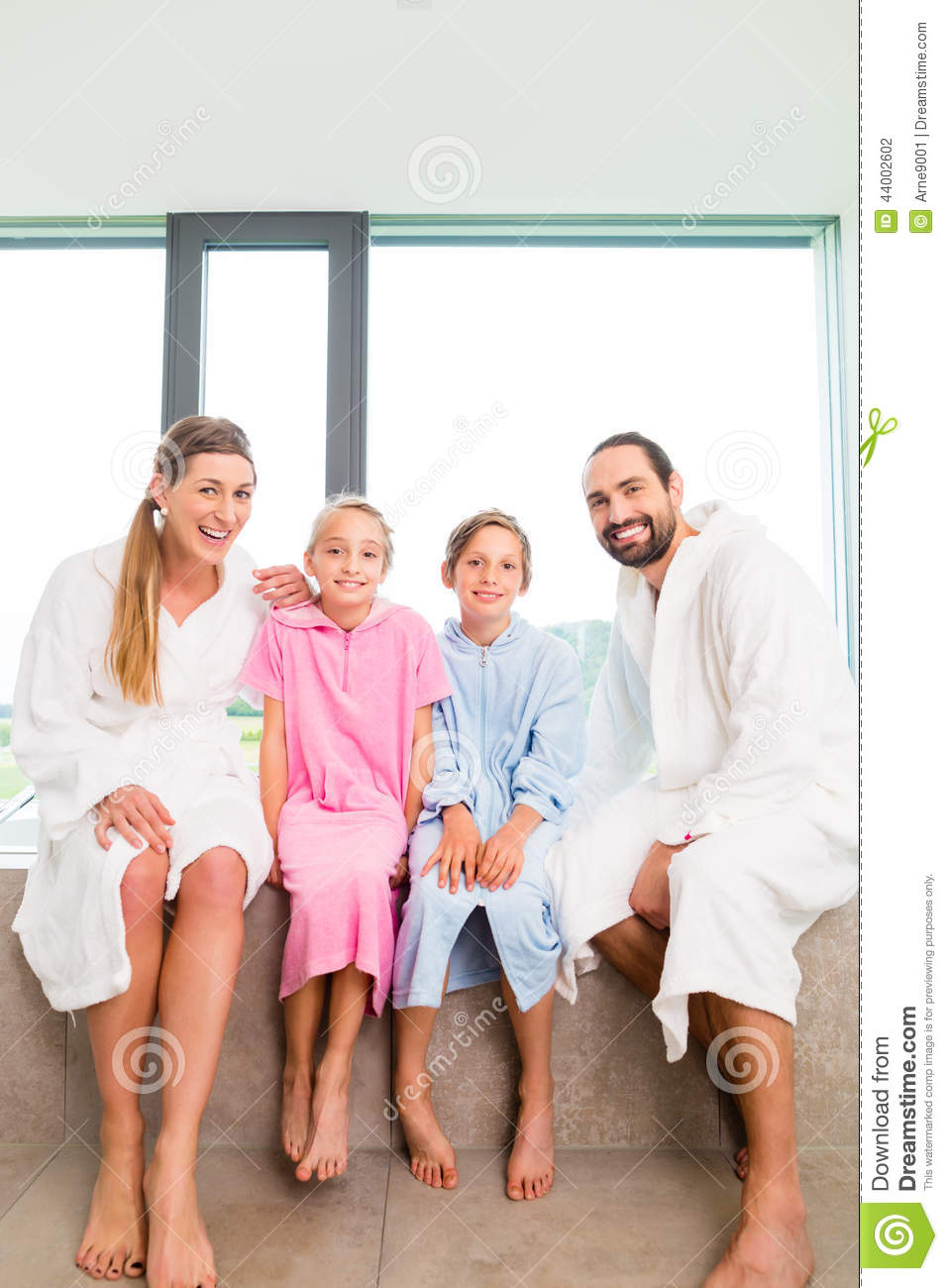 Family Sitting Together On Bathtub Stock Photo - Image: 44002602