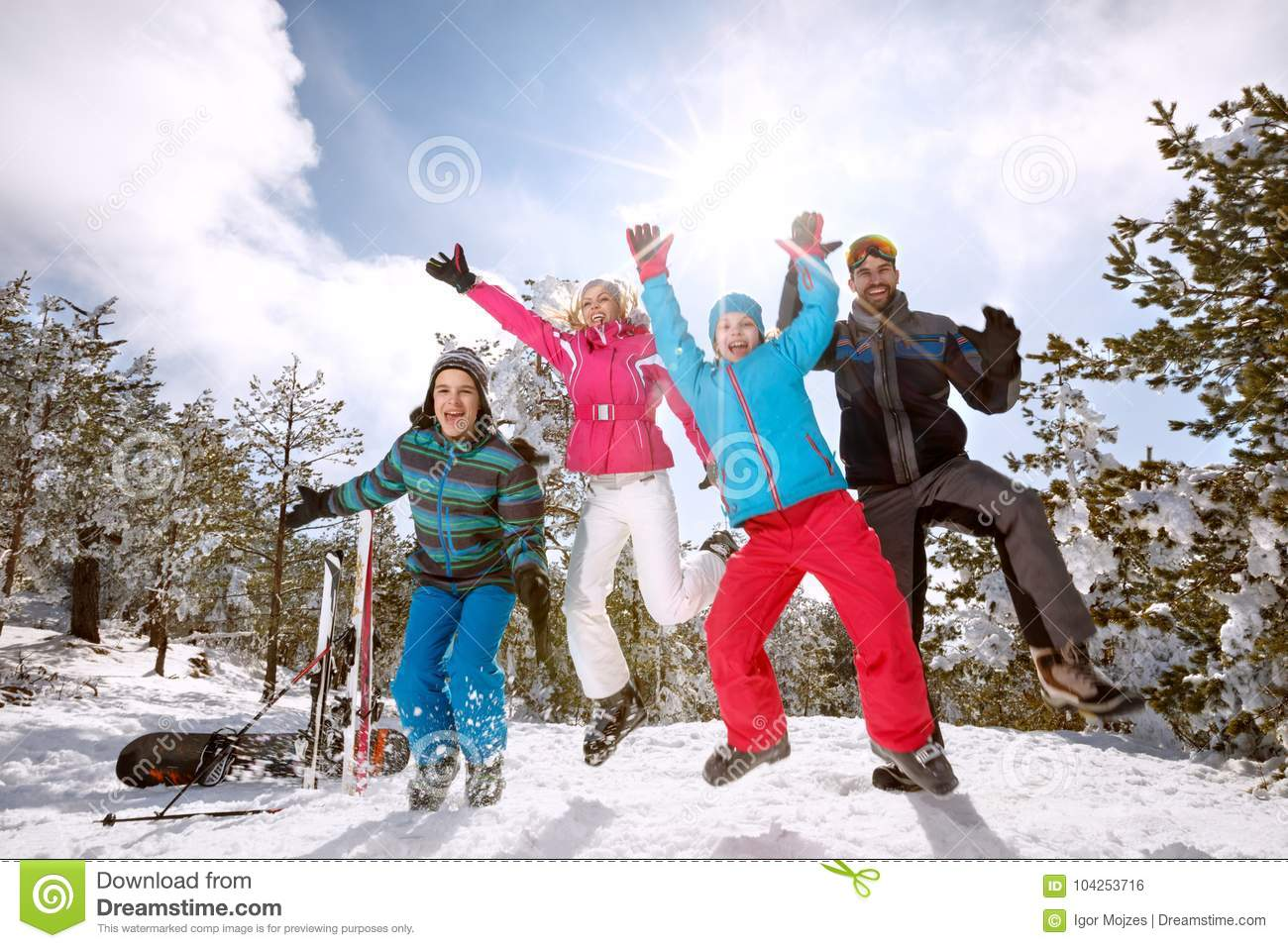 Family on skiing jumping on snow