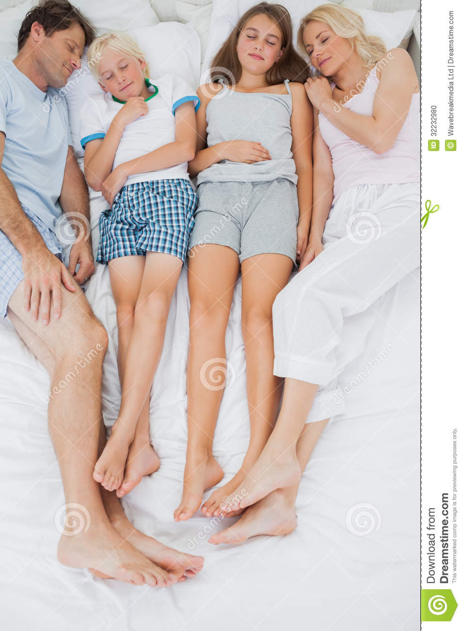 Family Sleeping In Bed Stock Photo Image 32232980