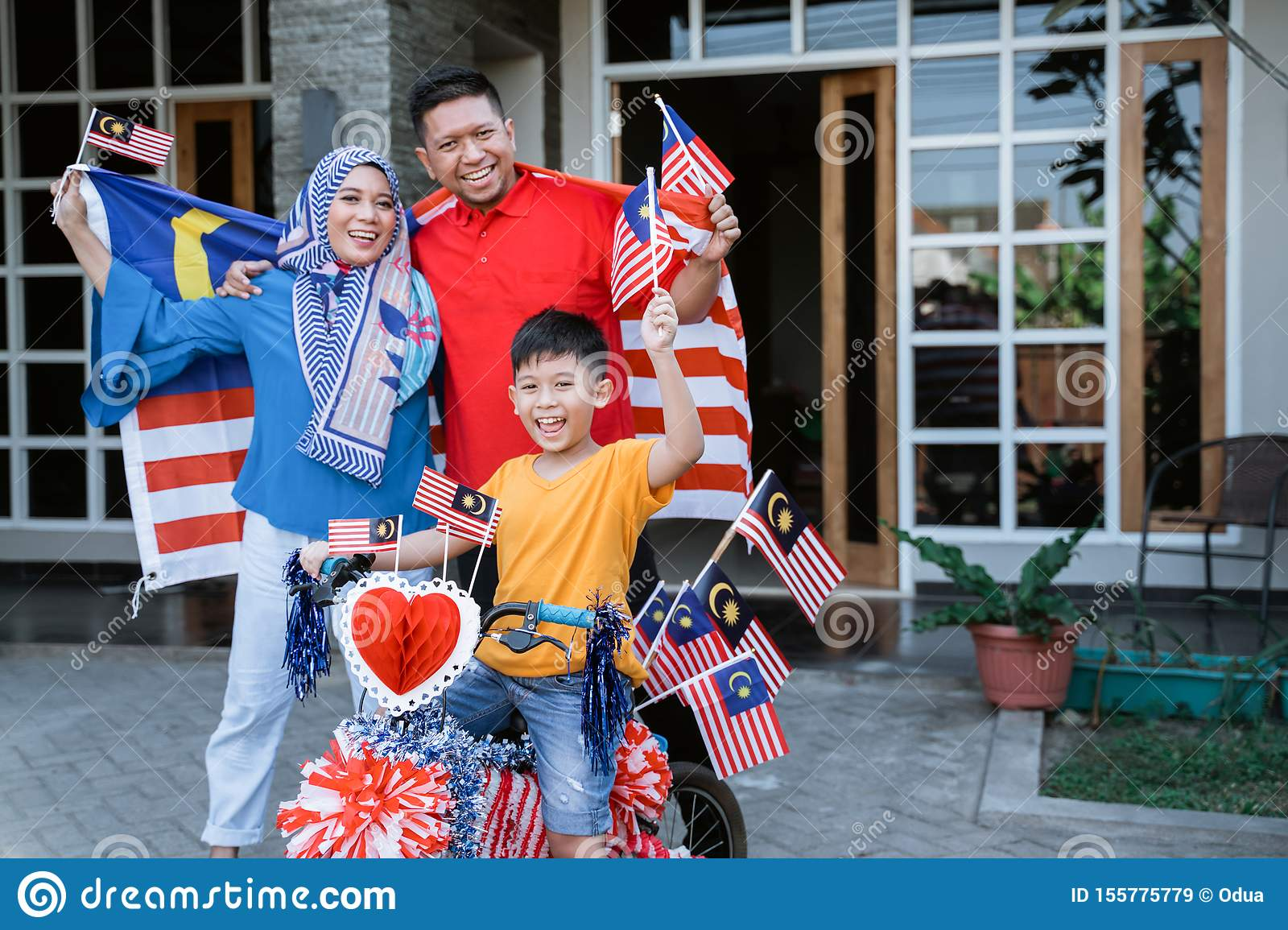 Family and son celebrating malaysia merdeka or malaysian independence day