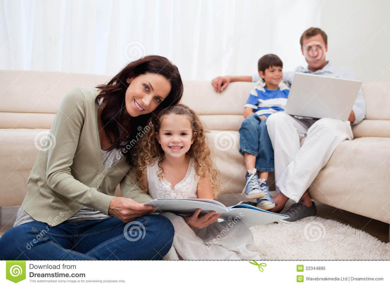 Family spending leisure time in the living room royalty for Family in the living room