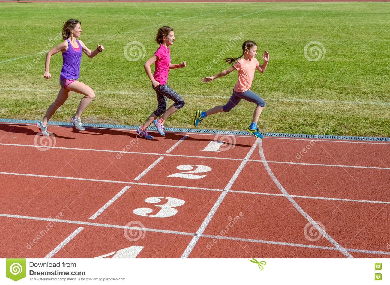 Family sport, mother and kids running on stadium track, training and children fitness