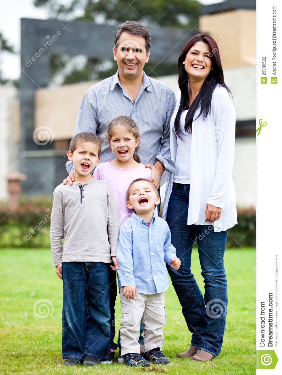 family standing outside house stock photo