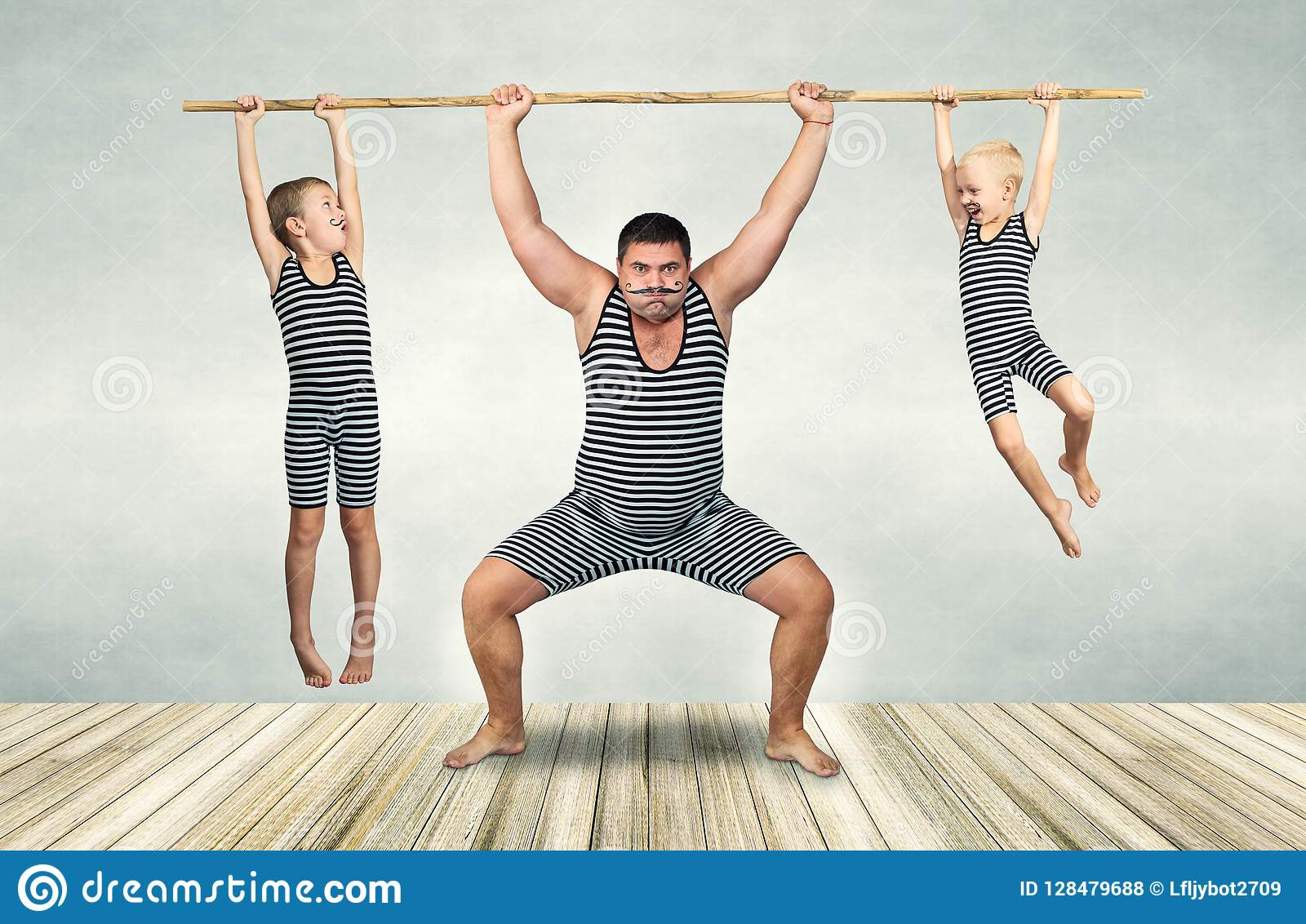Family of strongman. Father and two sons in vintage costumes drag the rope. Family look.