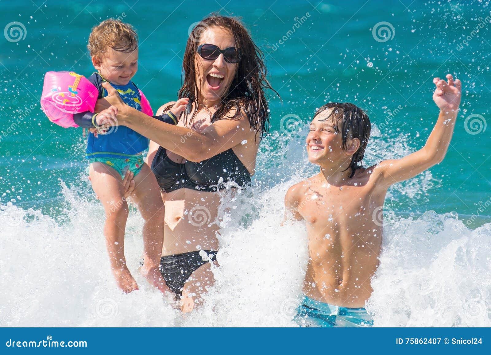 Family summer sea fun water splash