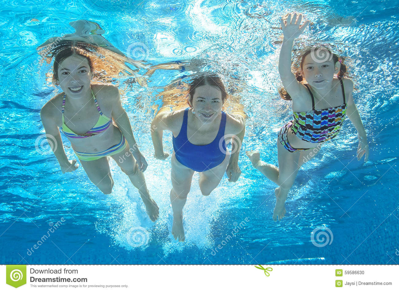 Family swim in pool or sea underwater mother and children - Swimming pool girl christmas vacation ...
