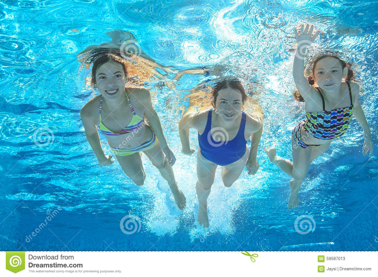 Family swim in pool or sea underwater mother and children for Family swimming pool