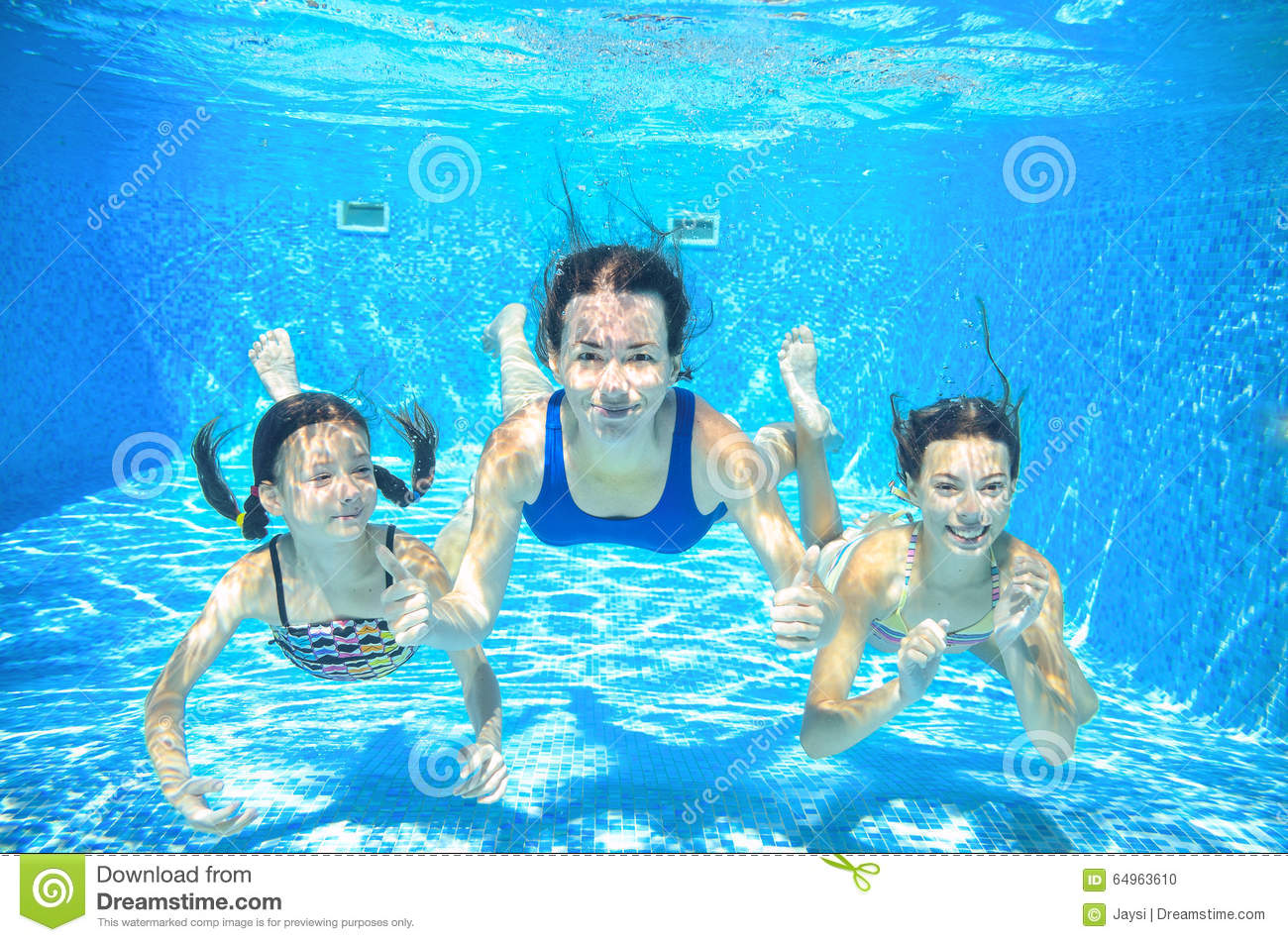 Family swim in pool underwater happy active mother and for Family swimming pool