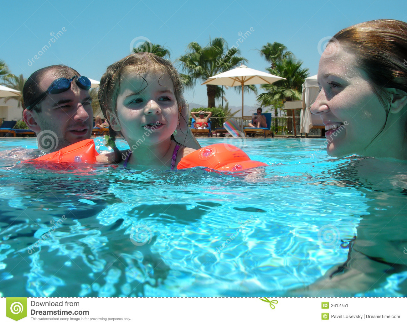 Stock images family swimming together images frompo for Family swimming pool