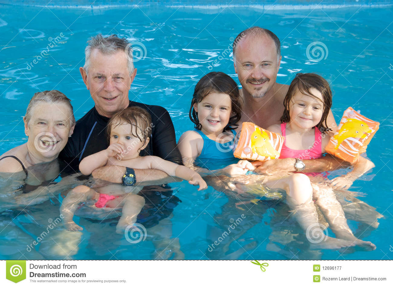 Family At The Swimming Pool Royalty Free Stock Photography Image 12696177
