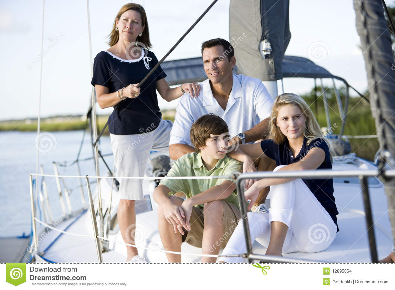 Family with teenagers relaxing together on boat