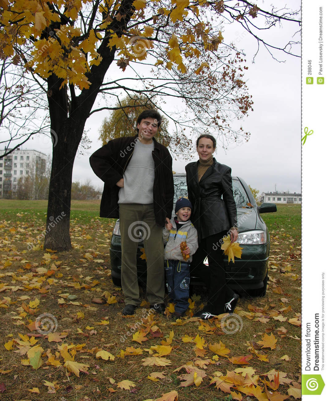 Family of three and car and autumn