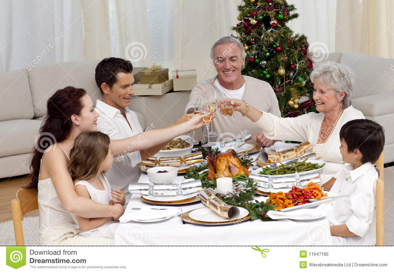 family toasting in a christmas dinner royalty free stock