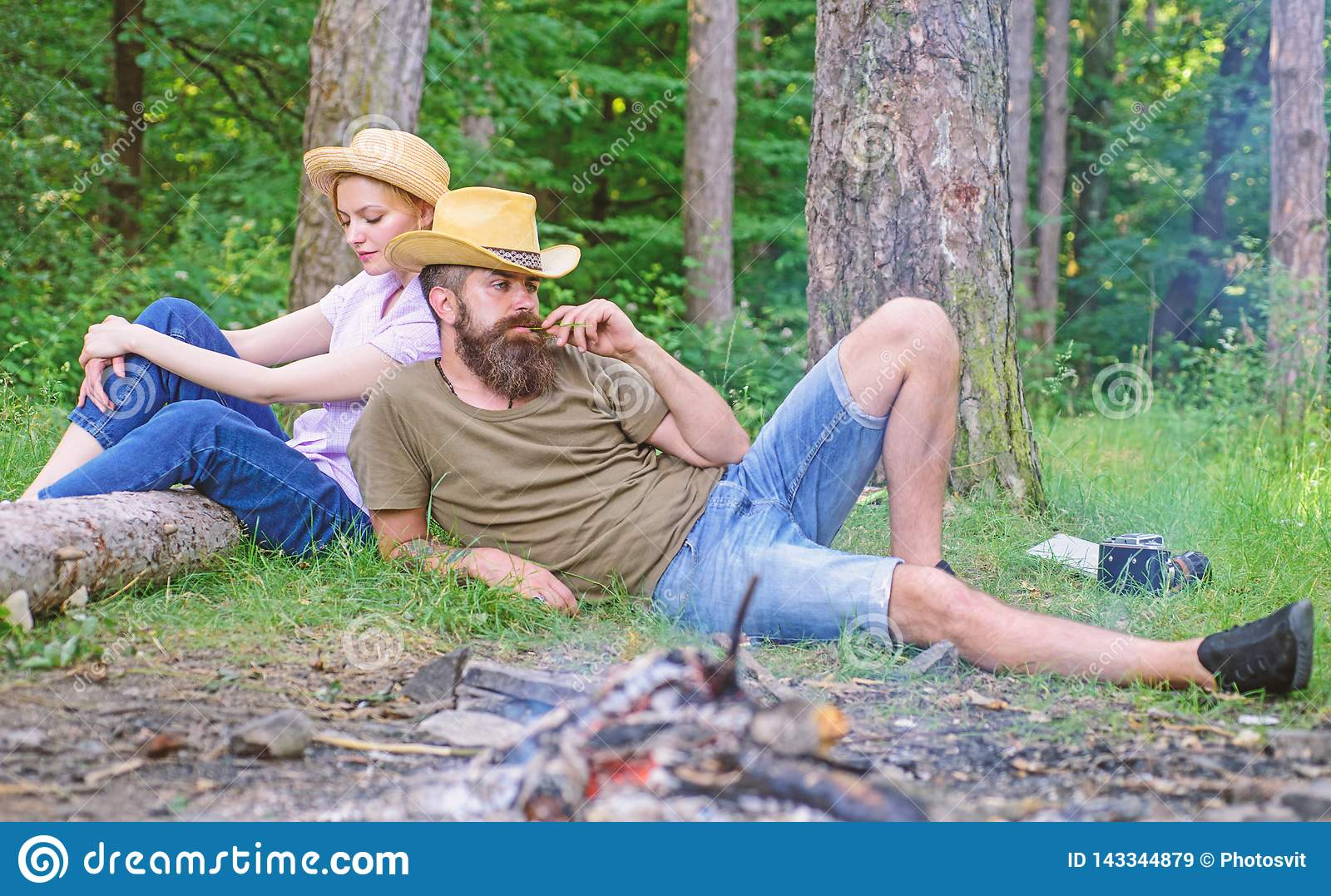 Family traditions. Family activity for summer vacation in forest and nature. Couple relaxing after gathering mushrooms