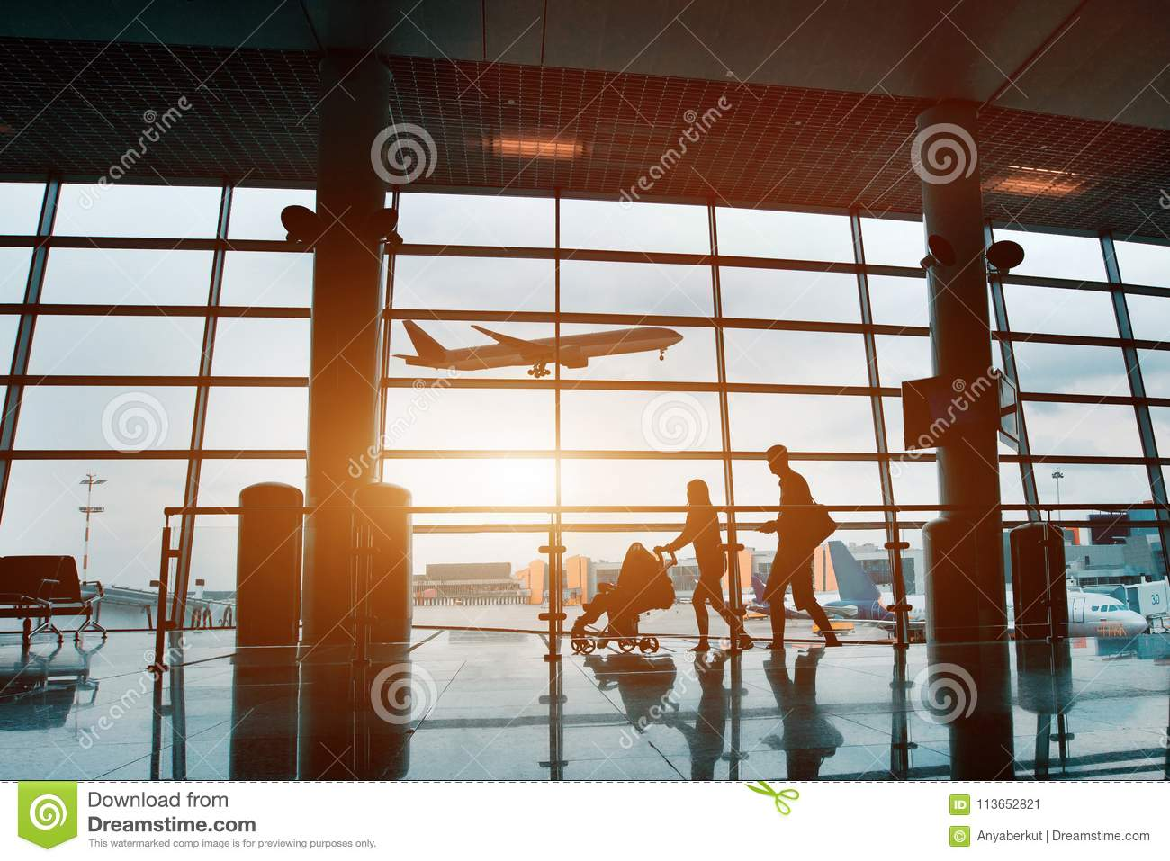 Family traveling with children, silhouette in airport