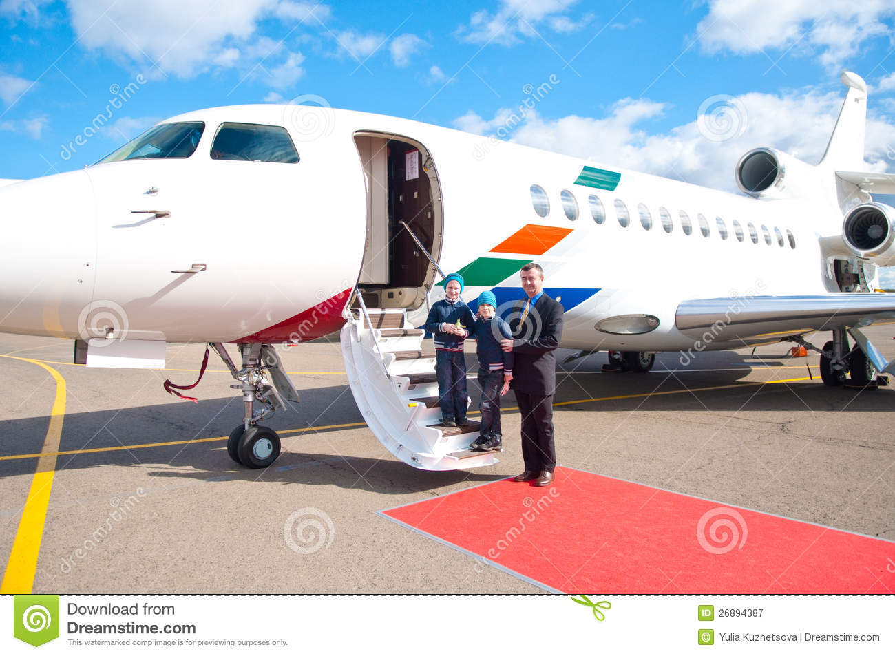 Family Travelling By Commercial Airplane Royalty Free Stock Photo