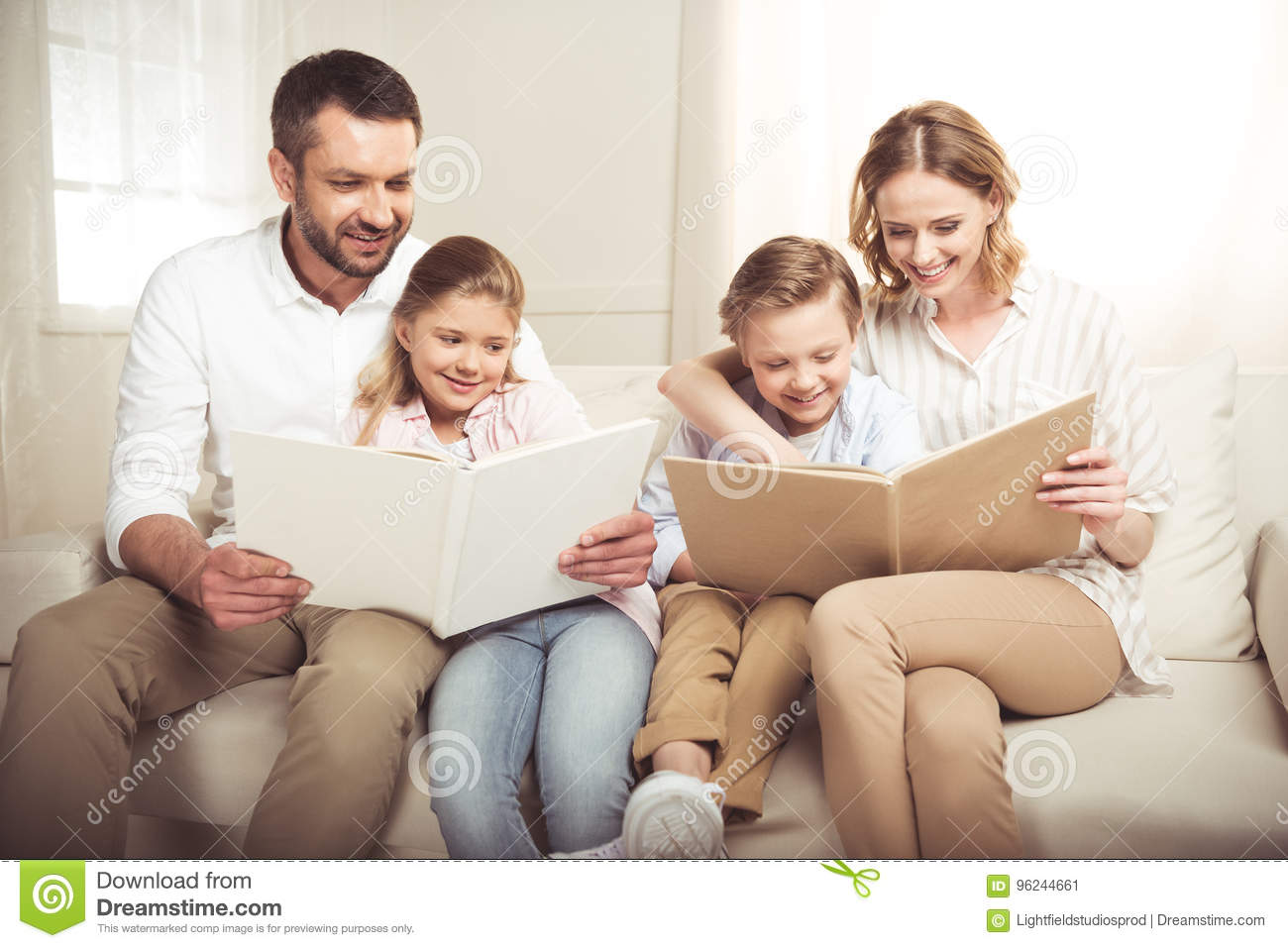 Download Family With Two Adorable Children Sitting Together And Reading Books At Home Stock Image - Image of reading, people: 96244661