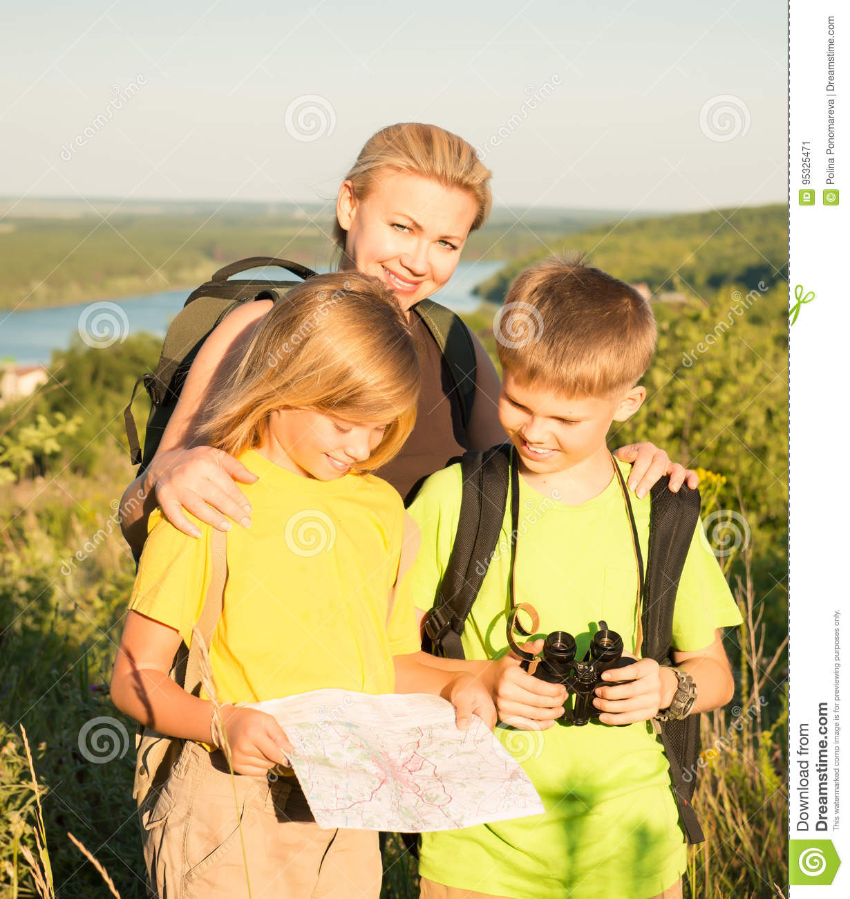 Family With Two Kids Looking At Map Family Travel Mother And C
