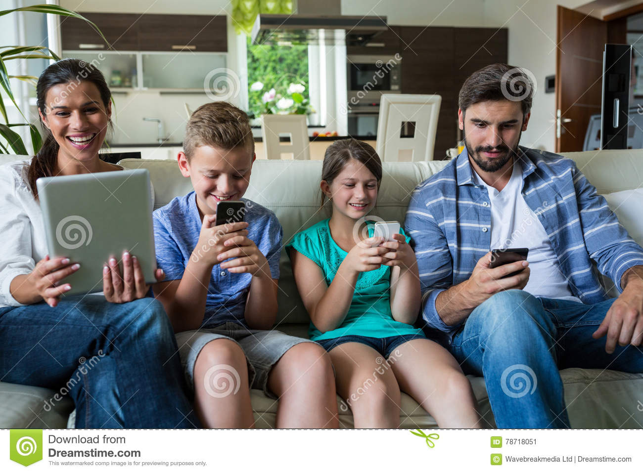 family using laptop and mobile phone in living room stock image image of father connection. Black Bedroom Furniture Sets. Home Design Ideas