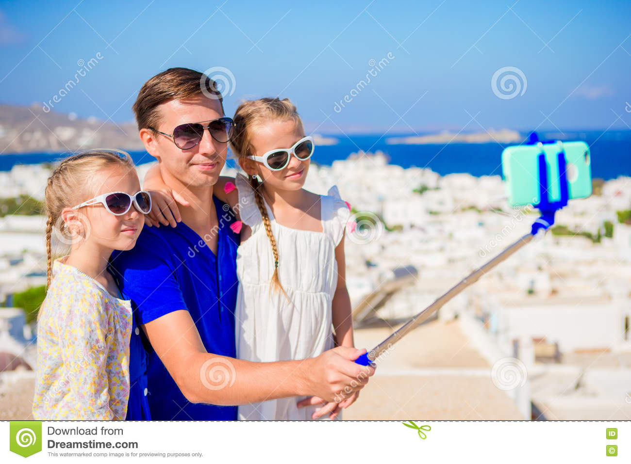 Download Family Vacation In Europe Father And Kids Taking Selfie Background Mykonos Town Greece