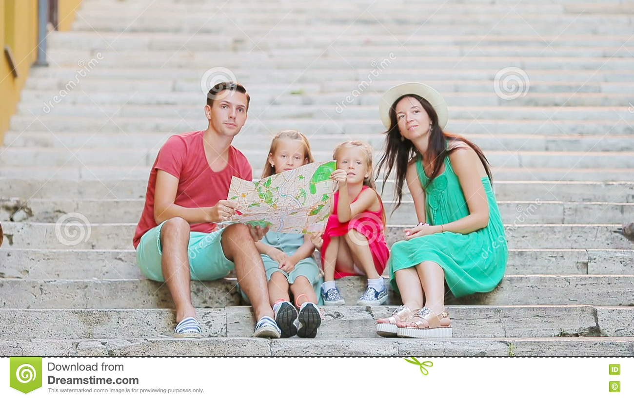 Family Vacation In Europe Parents And Kids With Touristic Map Searching The Attractions Stock Footage