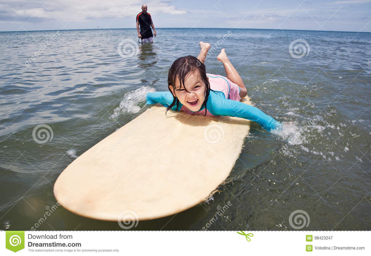 Family on vacation. Family Surfing. Summer holidays