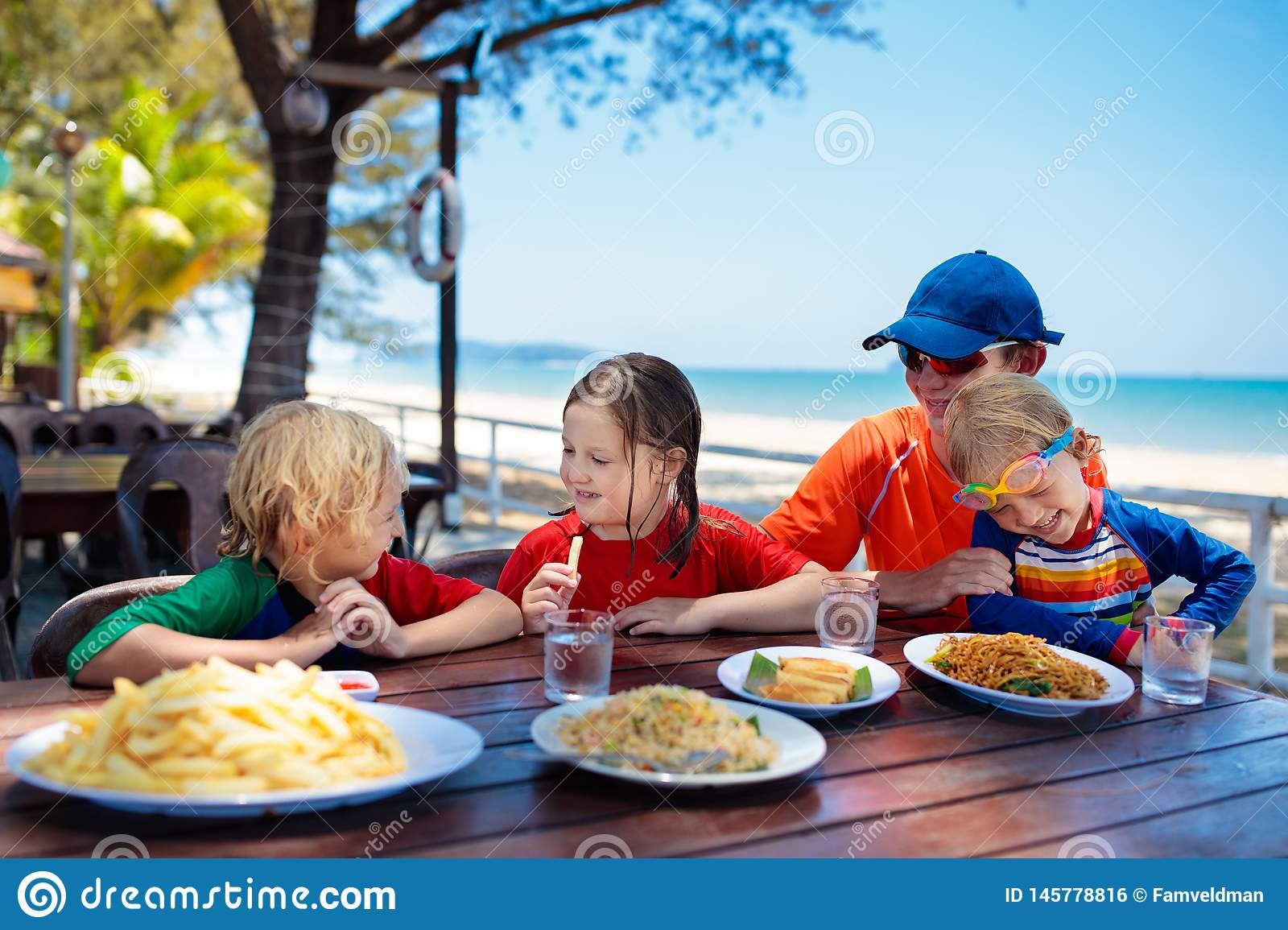 Family vacation lunch. Kids in beach restaurant